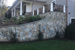 Photo of stone veneer landscape wall
